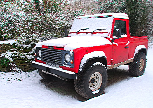 Land Rover Defender pickup in snow